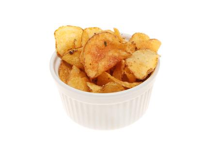 potato crisps: Potato crisps in a ramekin isolated against white