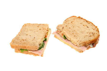 multi grain sandwich: Two halves of a ham sandwich made with multi grain bread isolated against white Stock Photo