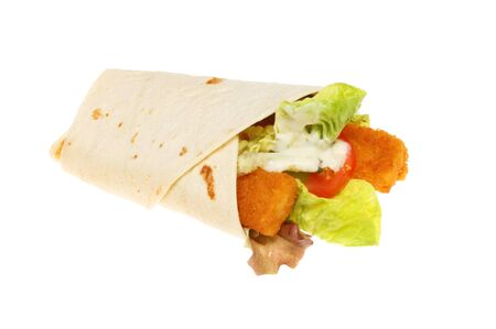 wraps: Fish fingers and salad with tartar sauce in a tortilla bread wrap isolated against white