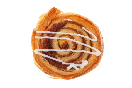 cinnamon swirl: Cinnamon swirl Danish pastry isolated against white