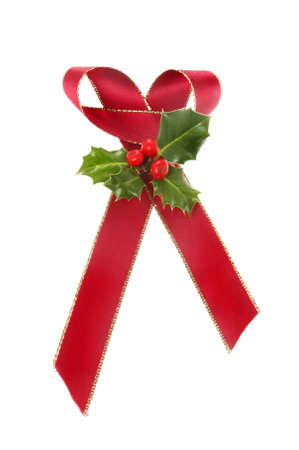 christmas motif: Christmas motif, gold edged red ribbon bow with a sprig of Holly isolated against white
