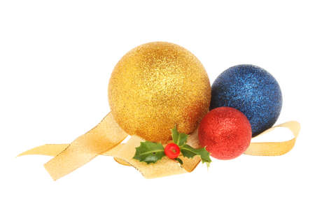 christmas motif: Christmas decoration, baubles with gold ribbon and a sprig of holly isolated against white Stock Photo