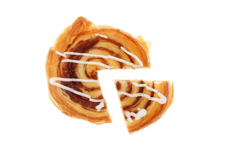 sweet segments: Danish pastry with a slice cut out isolated against white