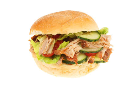bap: Pulled pork and salad in a soft white bread roll isolated against white