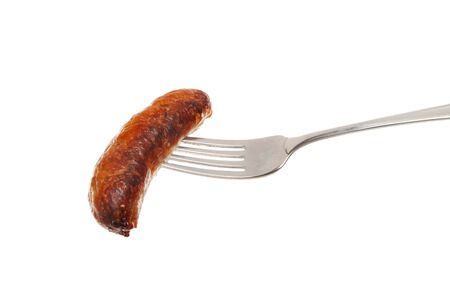 cooked sausage: Cooked sausage on a fork isolated against white