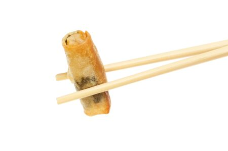 person appetizer: Spring roll held in chopsticks isolated against white