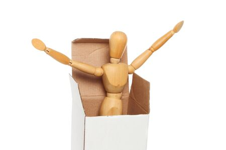 artists mannequin: An artists wooden manikin springs out of a cardboard box isolated against white Stock Photo