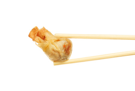moneybag: Oriental snack, a prawn moneybag held in chopsticks isolated against white