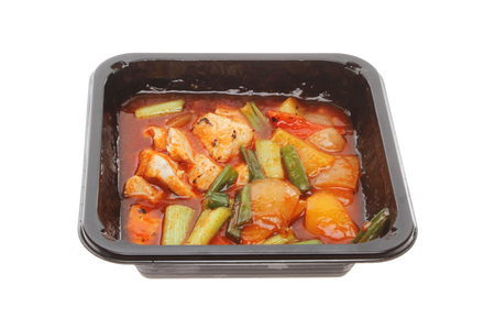 po: Chinese microwave meal, Kung Po Chicken, in a plastic carton isolated against white Stock Photo