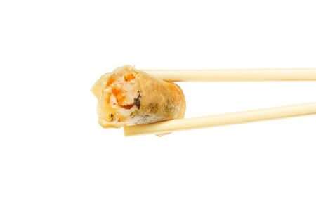spring roll: Prawn spring roll held in chopsticks isolated against white Stock Photo