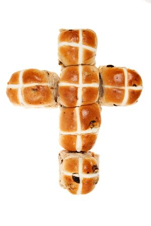 cros: Hot cros buns in the shape of a cross isolated against white