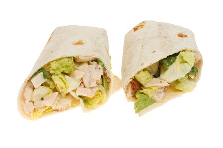 ensalada cesar: Two chicken Caesar salad sandwich wraps isolated against white