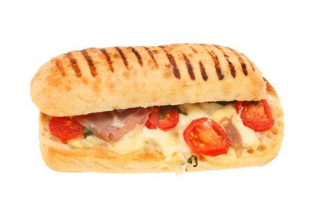 parma ham: Parma ham, mozzarella, tomato and basil pannini isolated against white Stock Photo