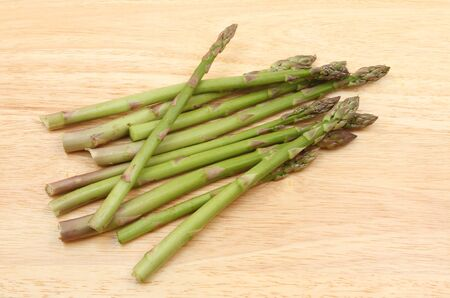 chopping board: Asparagus spears on a wooden chopping board Stock Photo