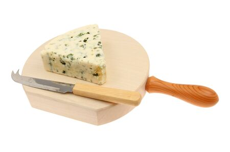 cheese knife: Wedge of Danish blue cheese with a cheese knife on a board isolated against white Stock Photo