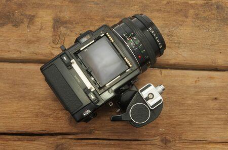 the medium: Medium format camera on old weathered wood