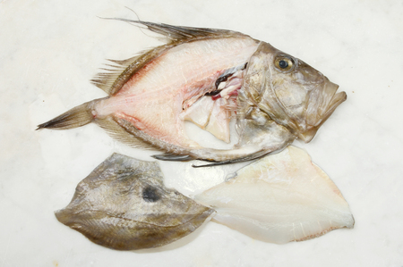 gutted: Filleted John Dory fish on a marble slab