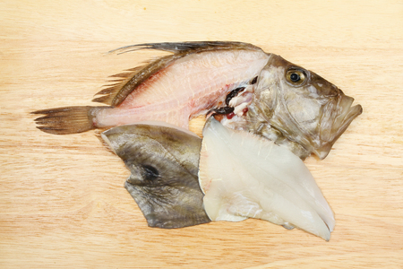 gutted: Filleted John Dory fish on a wooden chopping board