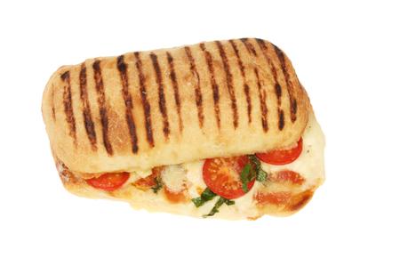 Mozzarella cheese, tomato, basil and pancetta panini isolated against white