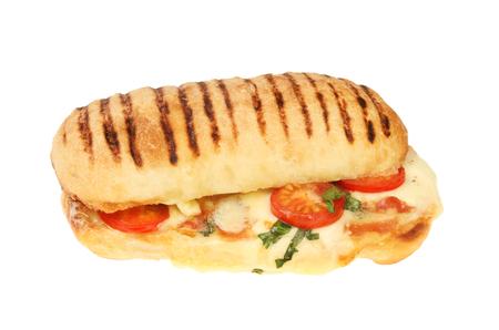 Mozzarella, tomato, basil and pancetta panini sandwich isolated against white