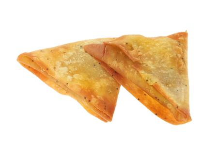 Two samosas isolated against white