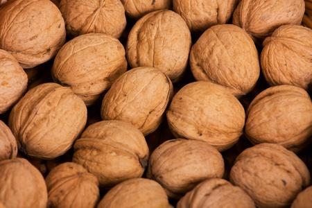 Many of ripe walnuts in a wicker basket photo