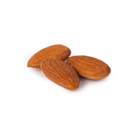 A few raw almonds isolated on white background