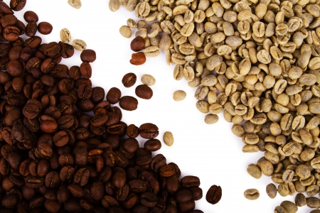 Heap of green and black coffee beans photo