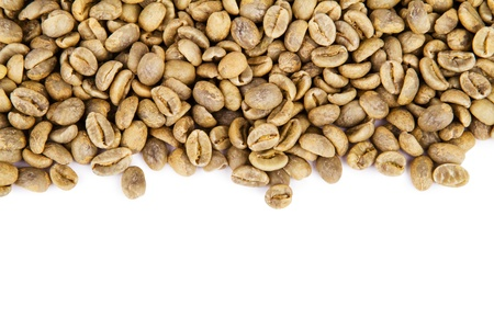 Heap of green coffee beans isolated on white background photo