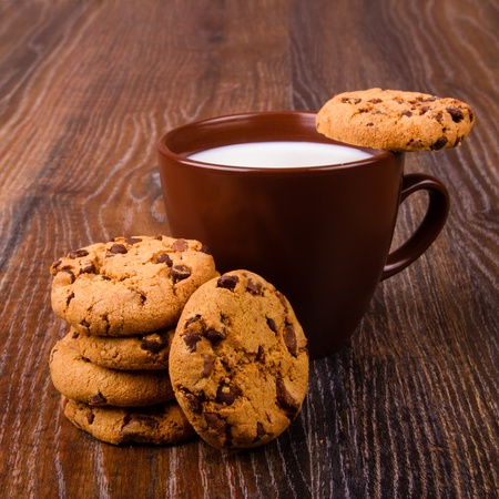 Chocolate chip cookies and a cup of milk photo