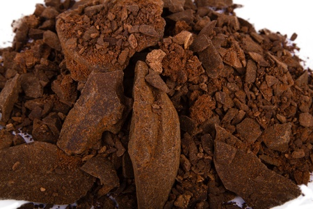 Heap of cocoa powder isolated on the white background photo