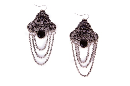 Pair of earrings isolated on the white background Standard-Bild
