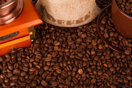 Coffee grinder with coffee beans, on a coffee beans background. photo