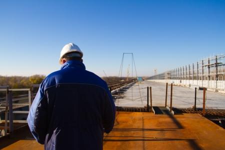 Construction inspection. Construction of a bridge across the river