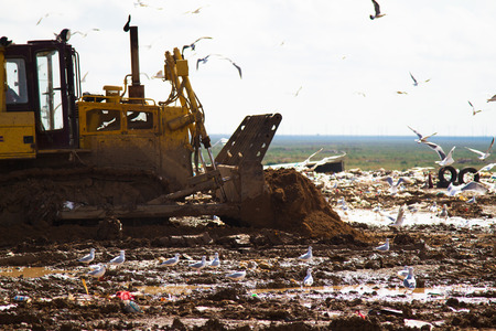 landfill site: Shot of bulldozers working a landfill site