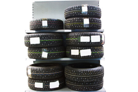 winter tires: New modern studded winter tires on the shelf in the store Stock Photo