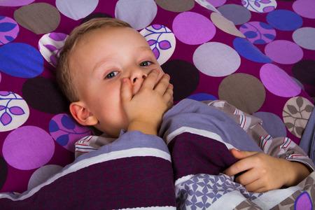 ��beautiful boy�: Sick little beautiful boy in the bed
