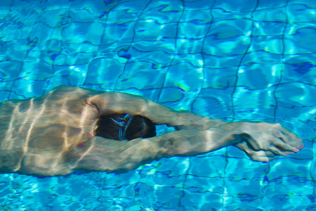 swimmer: Professional swimmer in the pool. Summer sunny day