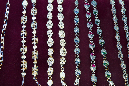 silver jewelry: Jewelry. Silver bracelet on a hand. In the shop window.