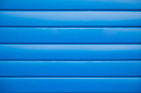 siding: House siding. Blue plastic panel siding texture.