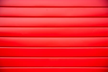siding: House siding. Red plastic panel siding texture. Stock Photo
