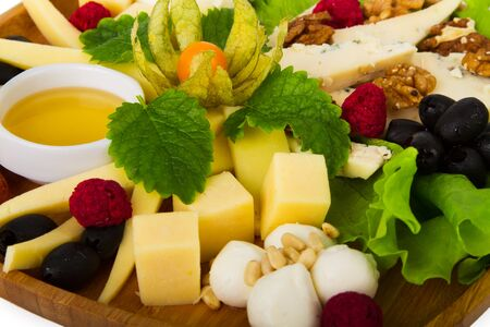 different types of cheese: Plate with different types of cheese. Close-up. Isolated on white.
