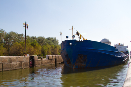 barge: Barge enters the lock of the Volga-Don canal