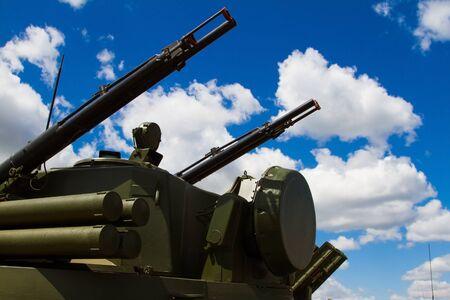 radar gun: Multifunction weapon complex with rocket launcher, heavy machine gun and mobile antiaircraft radar system, modern military industry Editorial