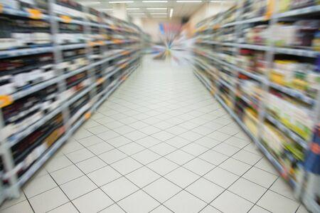 aisle: Empty supermarket aisle motion blur. Shopping in the supermarket