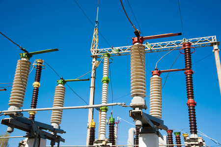 High voltage power transformer substation on blue sky background