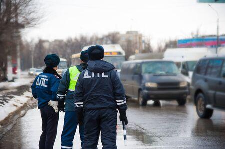 Inspector of traffic police regulates the movement of transport. Traffic policemen, DPS