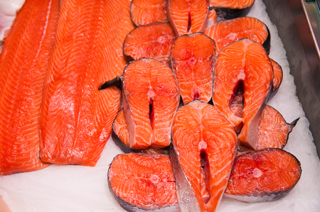 Fish meat product on shelf in the store. Pile of fish on ice Stock Photo