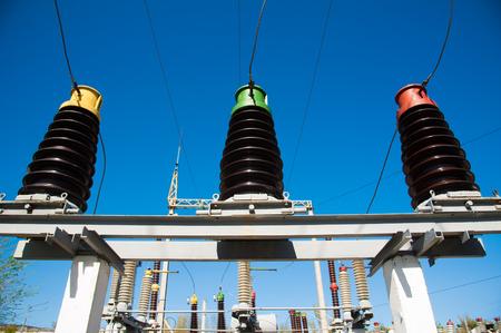 High voltage power transformer substation on blue sky background