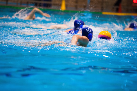 Water polo player in action during the women match between